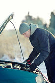 Man help with broken car with accumulator cable — Stock Photo