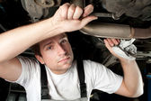 Auto mechanic working under the car — Foto Stock