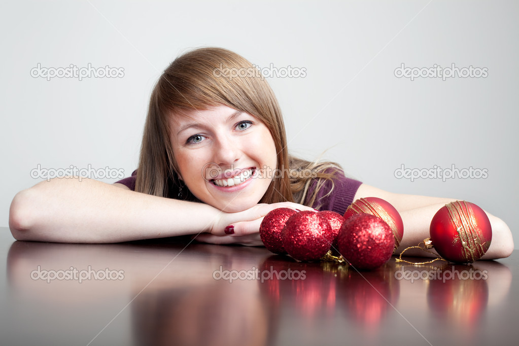 Beautiful woman with christmas bauble — Stock Photo #11989001