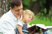 Father and daughter reading the Bible — Stock Photo