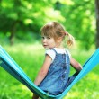 Little girl on a hammock - Lizenzfreies Foto