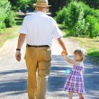 Grandfather and granddaughter — Stock Photo #11234370