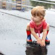 A beautiful little girl in the rain — Stock Photo