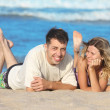 Couple on the shore of the sea - Stock Photo
