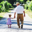 Grandfather and granddaughter — Stock Photo #11337173