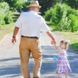 Grandfather and granddaughter — Stock Photo #11337415