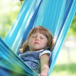 Little girl on a hammock - Stock Photo