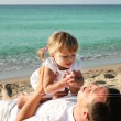 Stock Photo: Dad with baby on the shore of the sea