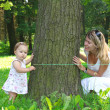 Mother with little girl on the nature — Stock Photo