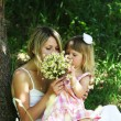 Beautiful little girl with her mother on the nature — Stock Photo #11377156