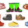 Collection of childrens shoes isolated — Stock Photo