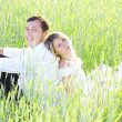 Newlyweds in a field of wheat - Stock Photo