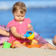 Child on the shore — Stock Photo #11497886
