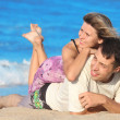 Couple in love on the sand — Stock Photo