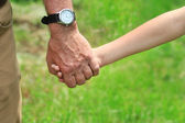 Father gives his hand to a child — Stock Photo