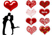Silhouette of a couple with hearts — Stock Photo