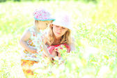 Mother and daughter playing on the field — Stock Photo