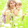 Mother and daughter on the field — Stock Photo #11690281