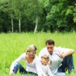 Young family in nature — Stock Photo #11690367