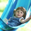 Little girl on a hammock - Stockfoto