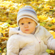 A beautiful little girl in autumn park — Stock Photo