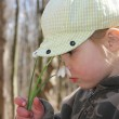 Child with flowers of snowdrops — Stock Photo #11690464
