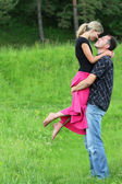 A young couple in love on the field — Стоковое фото