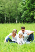 Young family in nature — Stock Photo