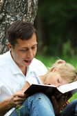 Father and daughter reading the Bible — Foto Stock