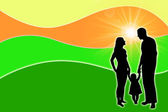 Silhouette of a family with the sun — Stock Photo