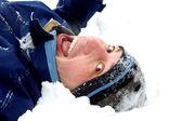 Man lies at snow — Stock Photo
