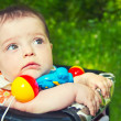 Stock Photo: Child in a baby carriage