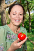 A woman with a tomato — Stock Photo