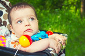 Child in a baby carriage — Stock Photo