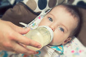 Adorable Seven month Baby eating from bottle — Stock Photo