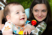Young mother with a charming baby — Stock Photo