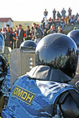 Russian police disperse riot — Stock Photo