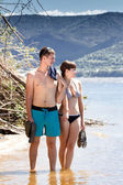 A young couple on the beach — Stock Photo
