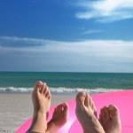 Beach feet on pink ring — Stock Photo