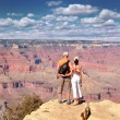 Couple Enjoying Beautiful Grand Canyon Landscape - Stock Photo