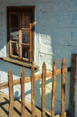 Old house with fence — Stock Photo
