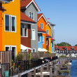 Colored houses near the water — Stock Photo