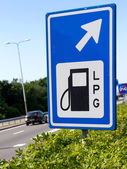 Filling station sign along a highway — Stock Photo