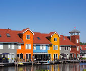 Colored houses with pier near the water — Stock Photo