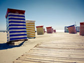 Colorful beach chairs on sunny sand — Stock Photo