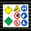 Hazard and safety symbols on door — Stock Photo
