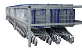 Isolated row of metal shopping carts — Stock Photo