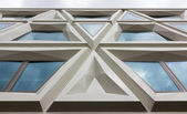 Modern facade of a building consisting of triangles — Stock Photo