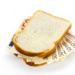 Slices of bread with euro banknotes sandwich filling — Stock Photo