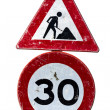 Road works and speed limit sign - Stock Photo